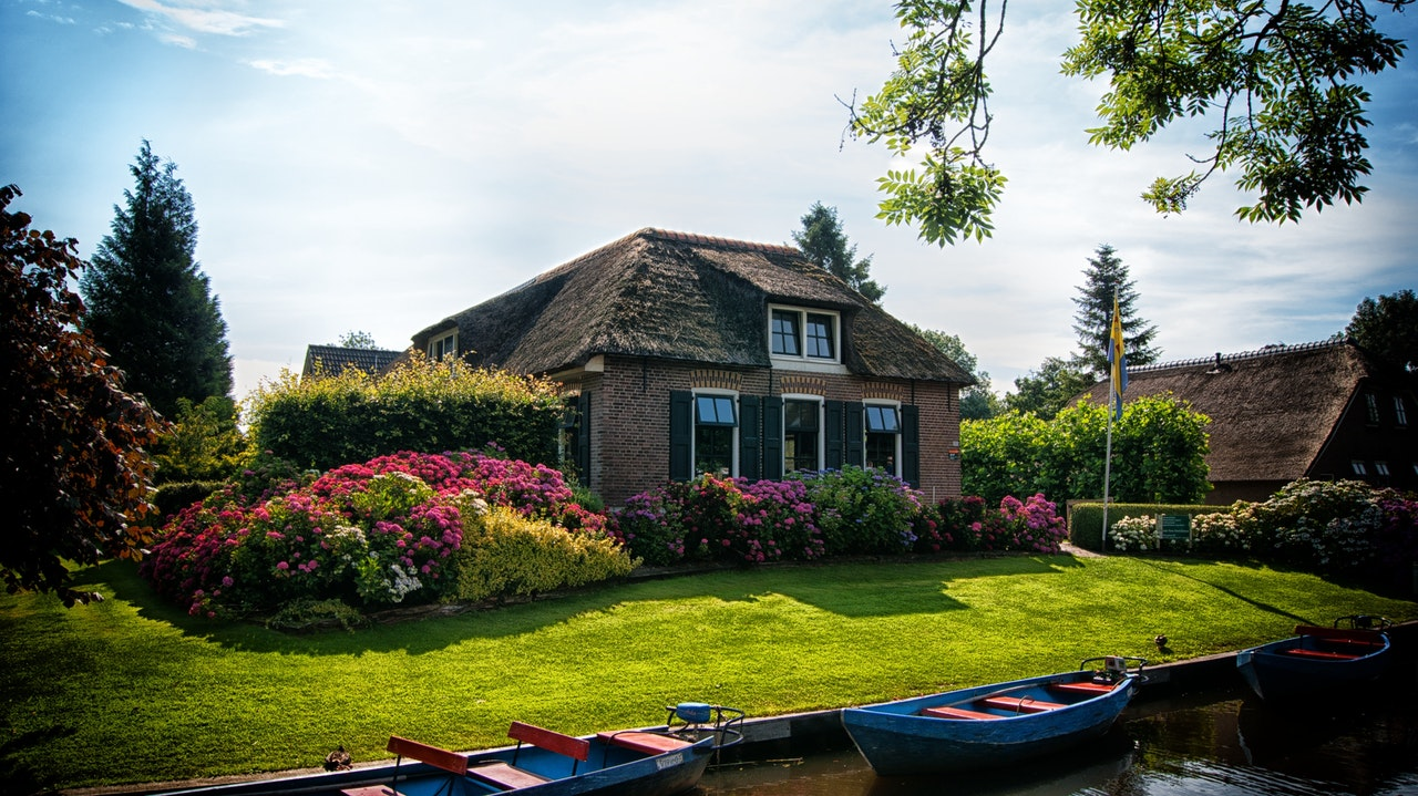 A holiday cottage near river with boats