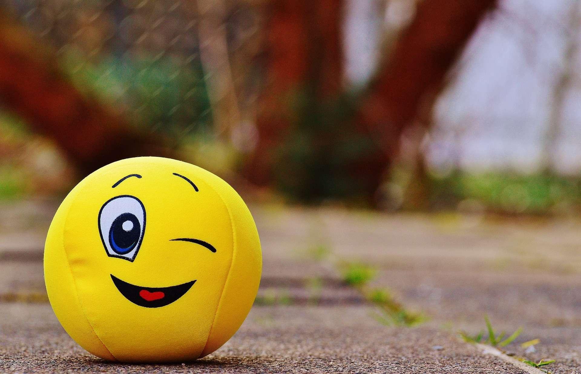 Yellow soft ball winking